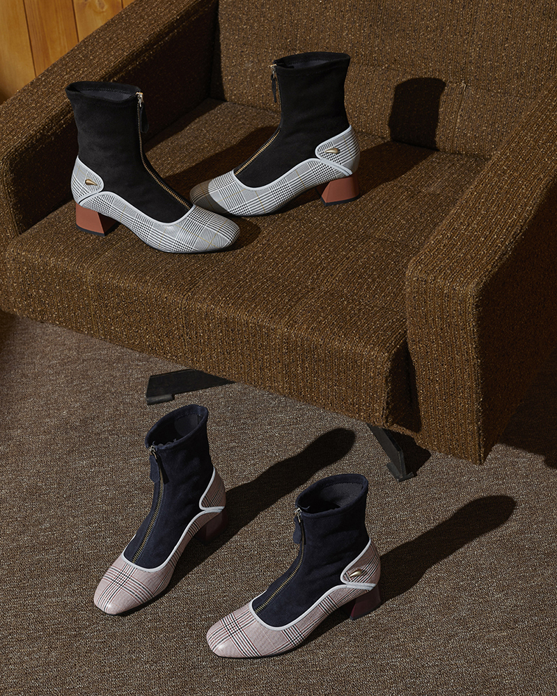 A still life fall winter campaign image of shoes with hard light