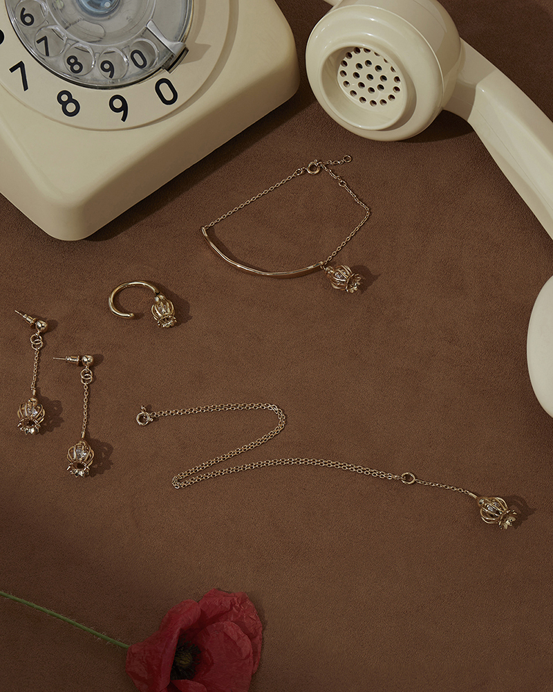 A still life fall winter campaign image of jewellery with hard light