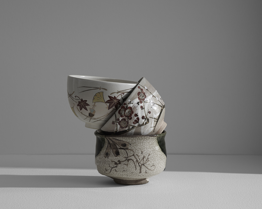 A still life image of ceramic pots assembled into a sculpture