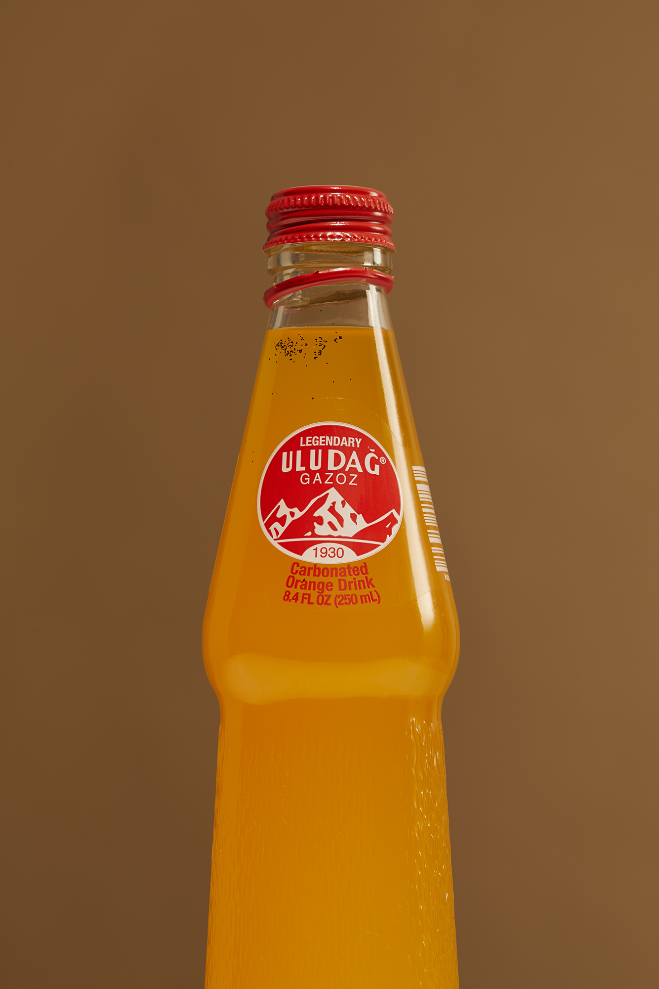 Still Life picture of a bottle of orange drink